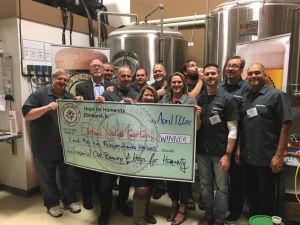 Hops for Humanity recently donated $10,000 to the Elmhurst Yorkfield Food Pantry.